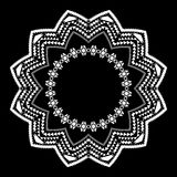 Tribal circle ornament on the black background. Stock Photos