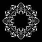 Tribal circle ornament on the black background. Royalty Free Stock Image