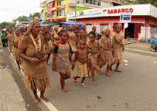 Tribal Clothes on Art and Cultural Festival 2017. Tribal clotes from Nabire, Papua on a parade. The typical brown clothes and bags known as Noken is made from Stock Photos