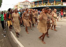 Tribal Clothes on Art and Cultural Festival 2017. Tribal clotes from Nabire, Papua on a parade. The typical brown clothes and bags known as Noken is made from Royalty Free Stock Photo