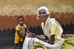 Tribal Culture. In the village of Purulia,an old woman and her grandson during their festival.They are too poor but still they preserve their own tradition Royalty Free Stock Images