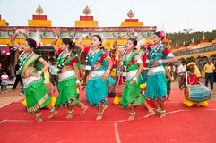 Tribal dance in India. BHUBANESWAR, INDIA - DECEMBER 20: Tribal folk dancers perform at the Toshali National Crafts fair on December 20, 2011 in Bhubaneswar Royalty Free Stock Photo