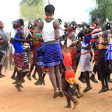 Tribal dance. Young men jumping during a tribal dance in Ethiopia Stock Images