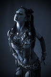 Tribal dancer in blue dark. Young beautiful tribal dancer woman in black and white with blue tint Stock Photography