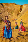 Tribal dancers. Women in ethnic costumes. Stock Photos