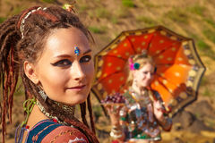 Tribal dancers. Women in ethnic costumes Stock Images