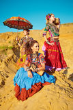 Tribal dancers. Women in ethnic costumes. Stock Photography