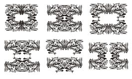 Tribal dragon symbols. Black on the white Royalty Free Stock Photos