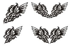 Tribal dragon wing and dragon heart with wings. Freakish dragon symbols. Black on the white Stock Photo