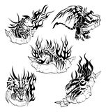 Tribal dragons with labels. Five tattoo with dragons, flame and hand-drawn labels for text Royalty Free Stock Image
