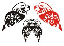 Tribal eagle head. Black and red on the white Stock Photography