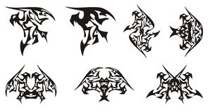 Tribal eagle symbols in the dragon form Royalty Free Stock Photo
