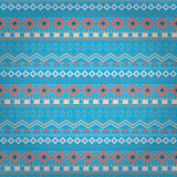 Tribal ethnic seamless stripe pattern on blue background Stock Photos