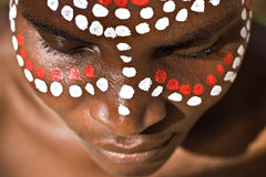 Tribal face. Young African girl, tribal painted face in white and red Royalty Free Stock Image