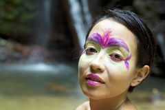 Tribal Face painting in jungle Stock Image
