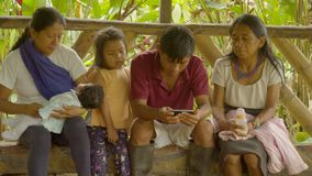 Tribe Family Sitting. Tribal Family Activities In Amazonian Jungle Village In Ecuador stock footage