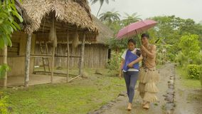 Tribe family walking. Tribal family activities in amazonian jungle village in Ecuador stock video footage