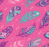 Tribal feathers pattern in blue, pink and purple colors. Vector creative illustration. Decorative feathers pattern. Tribal feathers in blue, pink and purple royalty free stock image