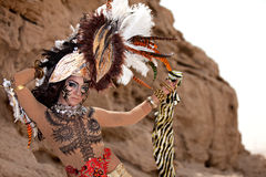 Tribal female wearing a feather head gear Royalty Free Stock Photos