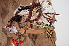 Tribal female wearing a feather head gear Royalty Free Stock Image