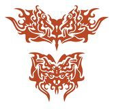 Tribal flaming butterflies formed by the eagle head Royalty Free Stock Image
