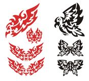 Tribal flaming eagle set. The flying stylized flaming eagle and eagle symbols in tribal style. Red and black options on a white background Stock Photography