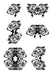 Tribal flaming lion head symbols. Tattoos of the growling lion's head. Black on the white Stock Photo