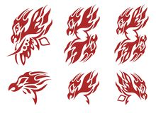 Tribal flaming phoenix head symbols. Red on the white. The head of a bird Phoenix with an open beak and an open wing in the form of fire in tribal style stock images