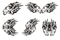 Tribal flaming symbols of the lion heads. Set of lion's symbols. Tribal flaming black lion head on a white background Royalty Free Stock Photos