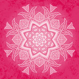 Tribal flower over pink background Royalty Free Stock Images