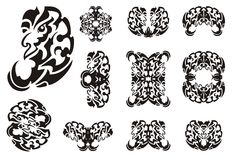 Tribal freakish dragon symbols. Big collection of the twirled wavy symbols of the dragon head for the decorative purposes. Black on the white Stock Photography