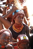 Tribal girl. Girl of an indigenous tribe in ethiopia staring in the lense Stock Photo