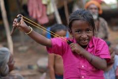 A tribal gypsy boy holding asling shot