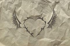Tribal heart on crushed paper background Royalty Free Stock Photos
