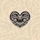 Tribal heart. Vector illustration, silhouette on a tribal background Stock Photography