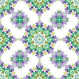Tribal indian ethnic seamless design. Festive lilac green on white mandala pattern.  Stock Photos