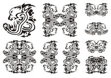 Tribal lion head with a snake Stock Photos