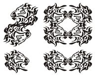 Tribal lion head symbols. Black on the white Royalty Free Stock Photo