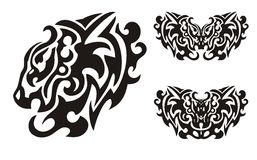 Tribal lion head and symbols of butterflies formed by the eagle head Royalty Free Stock Images