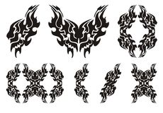 Tribal lion wing symbols. Black on the white Royalty Free Stock Photography
