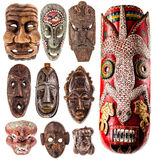 Tribal mask collection. A collection of different tribal ethnic ancient wooden masks from around the world isolated over a white background Stock Images