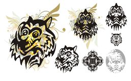Tribal monster wolf head with splashes and the head of the monster. Set of the heads of the monster for a carnival. Tribal grunge wolf head with floral splashes Stock Photography