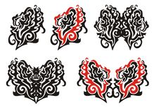 Tribal ornate leaf and ornate elements. Ornate flaming twirled leaf and butterflies in tribal style ready for a tattoo Stock Photo