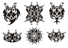 Tribal owl symbols. Black on the white Royalty Free Stock Photography