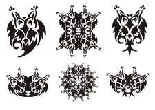 Tribal owl symbols. Black on the white. Flaming ornate freakish owl set, owl circle and other royalty free stock photography