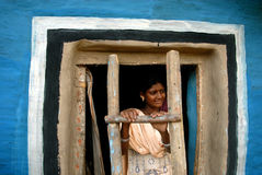Tribal Painting in India. October 29,2011 Nimdihi,Raghunathpur,Jharkhand,India,Asia-An adolescent girl standing in her painted house at the remote village of Stock Image