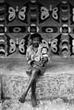 Tribal Painting in India. November 12,2011 Rampurhut,Birbhum,West Bengal,India,Asia-A man holding his grand child infront of their house wall in a tribal village royalty free stock images