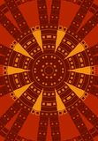 Tribal Pattern Circle in Red. A tribal style texture background pattern in red, gold and brown colors Royalty Free Stock Image