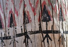 Tribal pattern on wood texture stock image