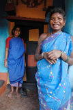 Tribal People in India. Koraput,Orissa,India,January 29,2011-Tribal women pose for portraits at their painted house in Orissa stock photography